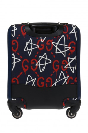 Patterned suitcase od Gucci