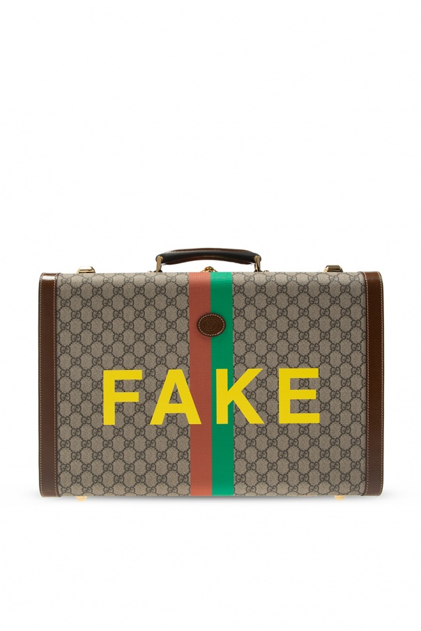 Gucci Suitcase with logo