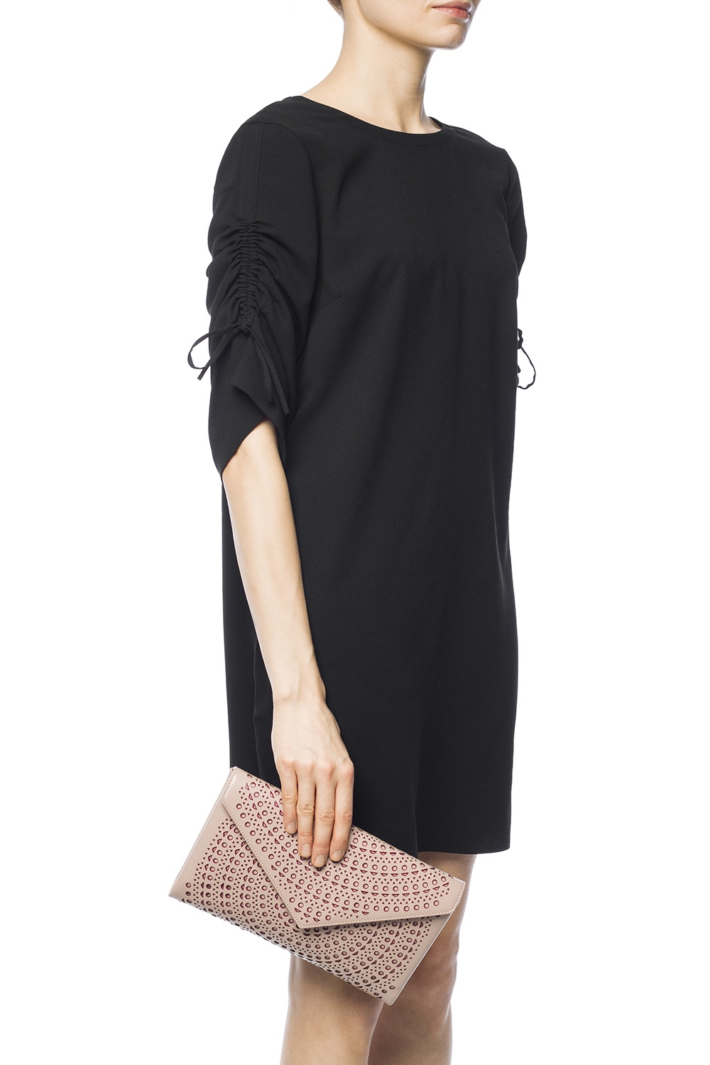 Alaia Perforated clutch