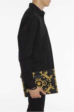 Patterned clutch od Versace